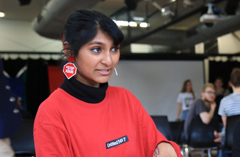 Grace talks at an organising day, wearing her #StopAdani earrings.