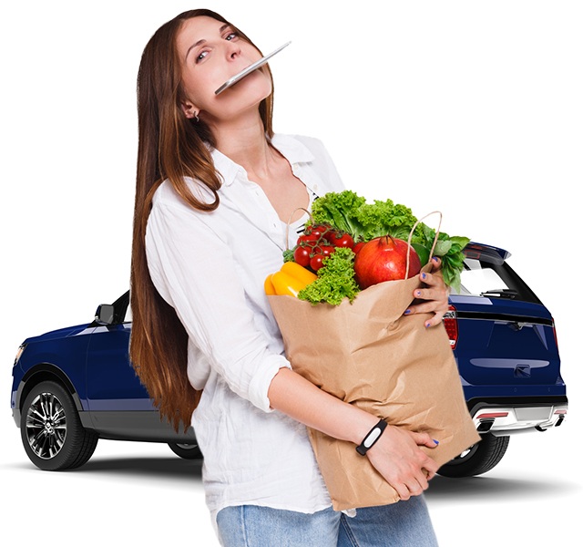 Woman carrying groceries to a shared Getaround® car