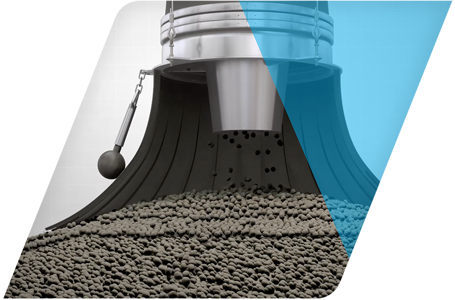 An animation frame of a side cut-out of a loading spout with material flowing into a bin.