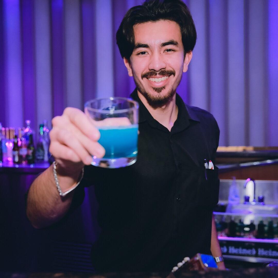 Staff Shop bartender preparing a cocktail