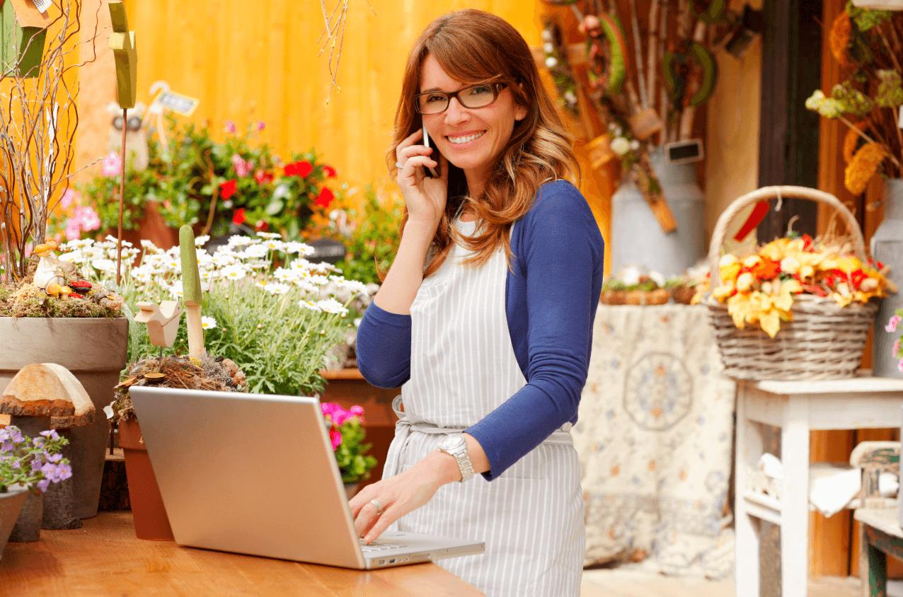 flower shop owner on a laptop