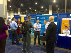 Veoci team members at a conference.