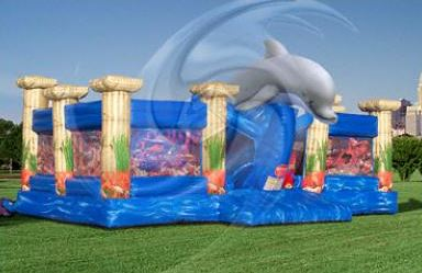 Atlantis is a large activity attraction that features a giant dolphin, two large bounce areas, giant slide, pop-up sharks and a huge treasure chest. (36' l x 35' w x 17' h)