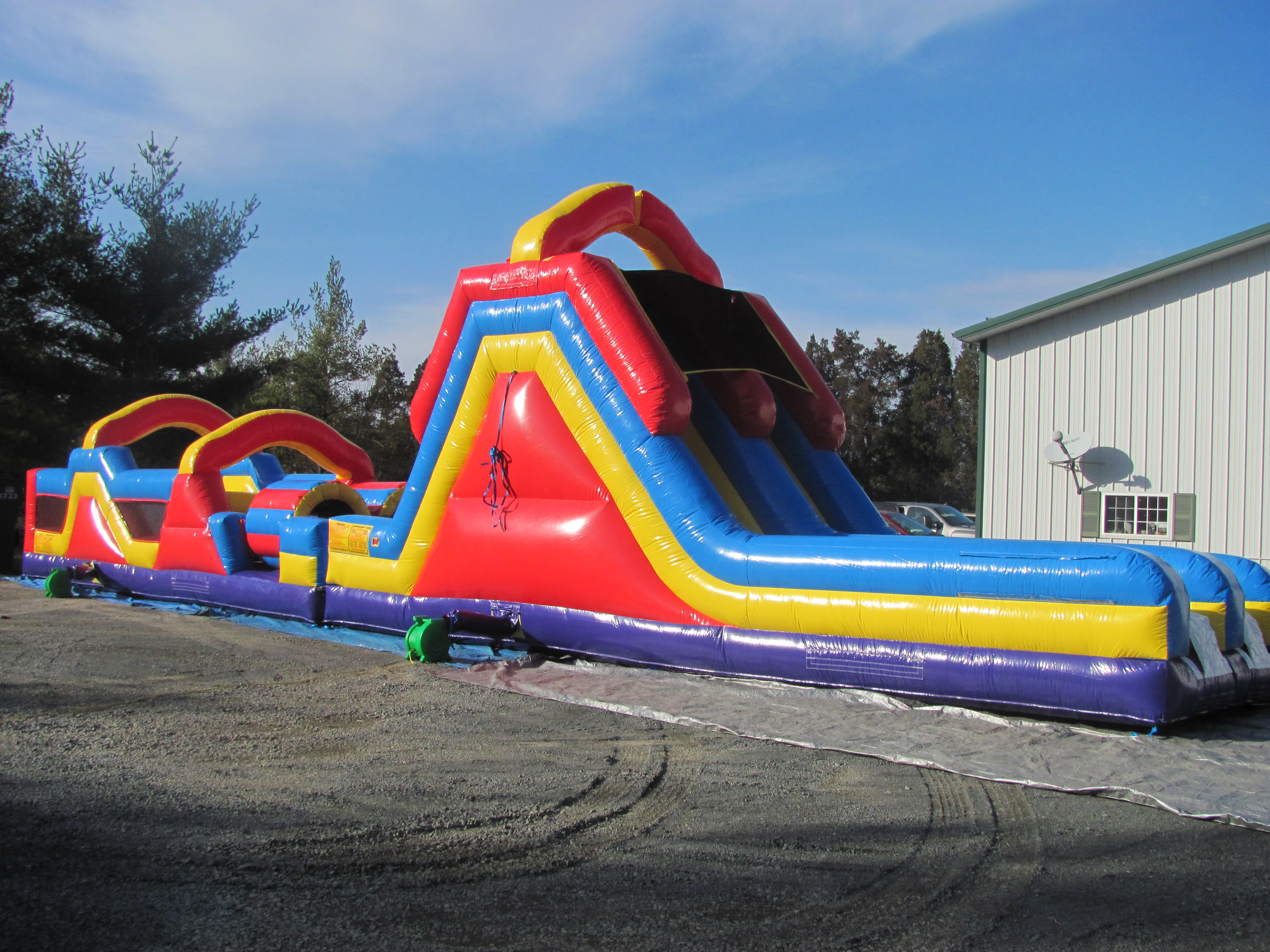 The Monster Obstacle Course inflatable play structure features pop-ups, climbs and slides. (70' l x 12' wx 18' h)