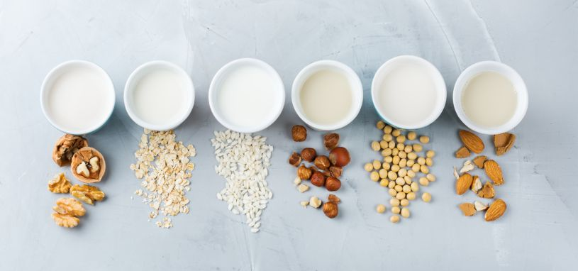 view from atop of different types of milk alternatives laid out