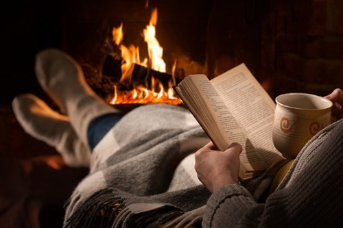 Reading in front of the fire