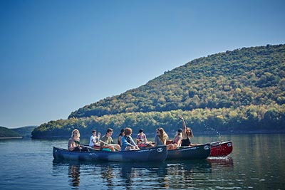 Group shot of kayakers on a picturesque lake