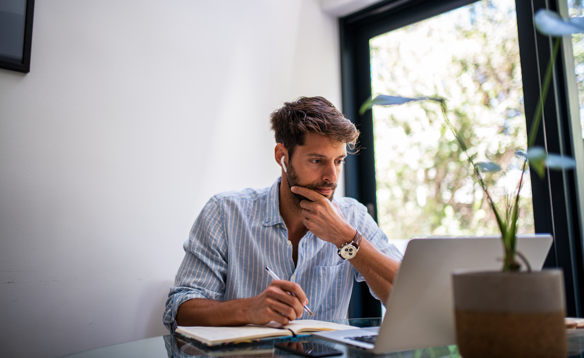 man doing research on computer