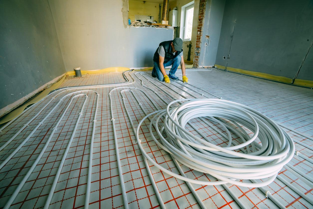 workers installing geothermal floor heating