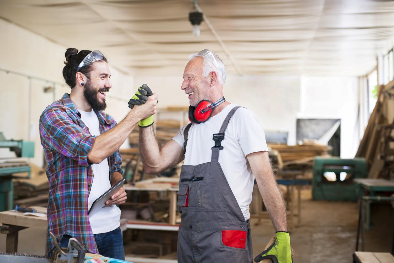 two men celebrating in shop