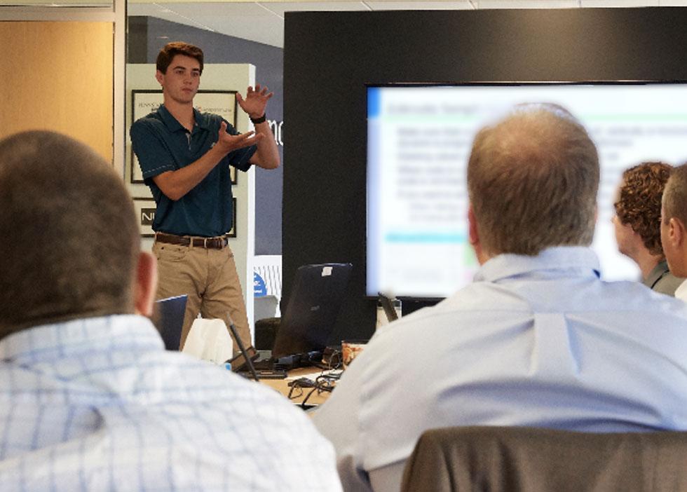 AdvanceTEC intern presenting calculations to management team