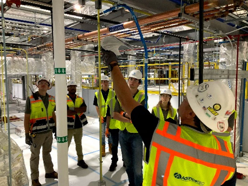 AdvanceTEC intern using oculus virtual reality software to walkthrough a cleanroom project