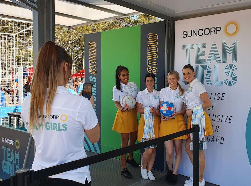 girls having photo taken at green screen event