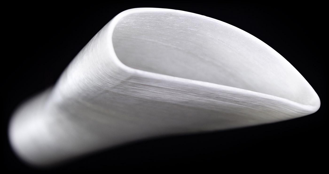 A closeup shot of a fiberglass turbine blade partial print