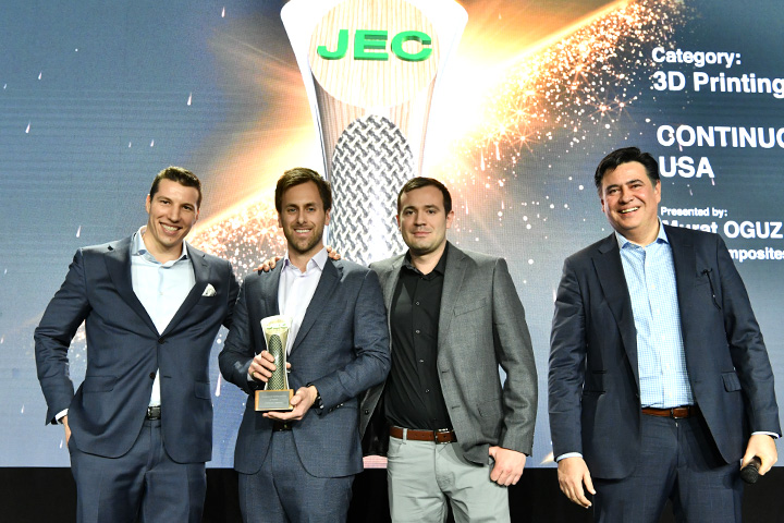 Continuous Composites team smiling at JEC World as they receive their award