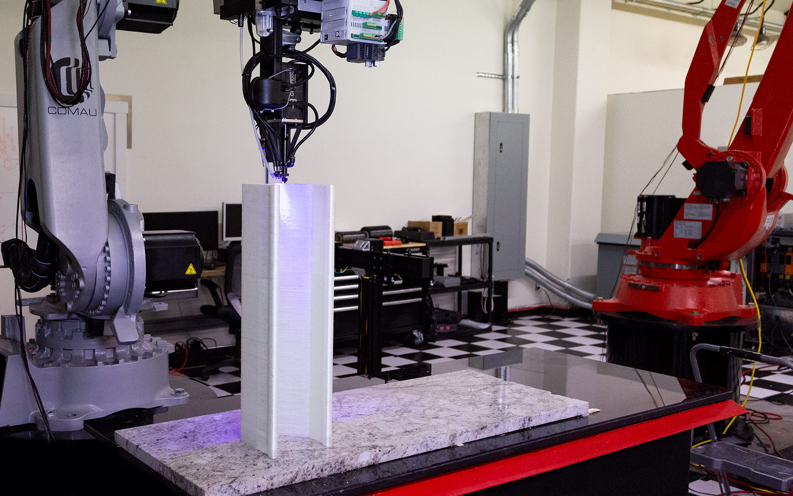Wide view of robot printing fiberglass composite part with CF3D