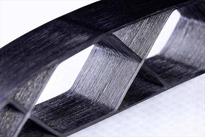 Closeup image of continuous carbon fiber airfoil part