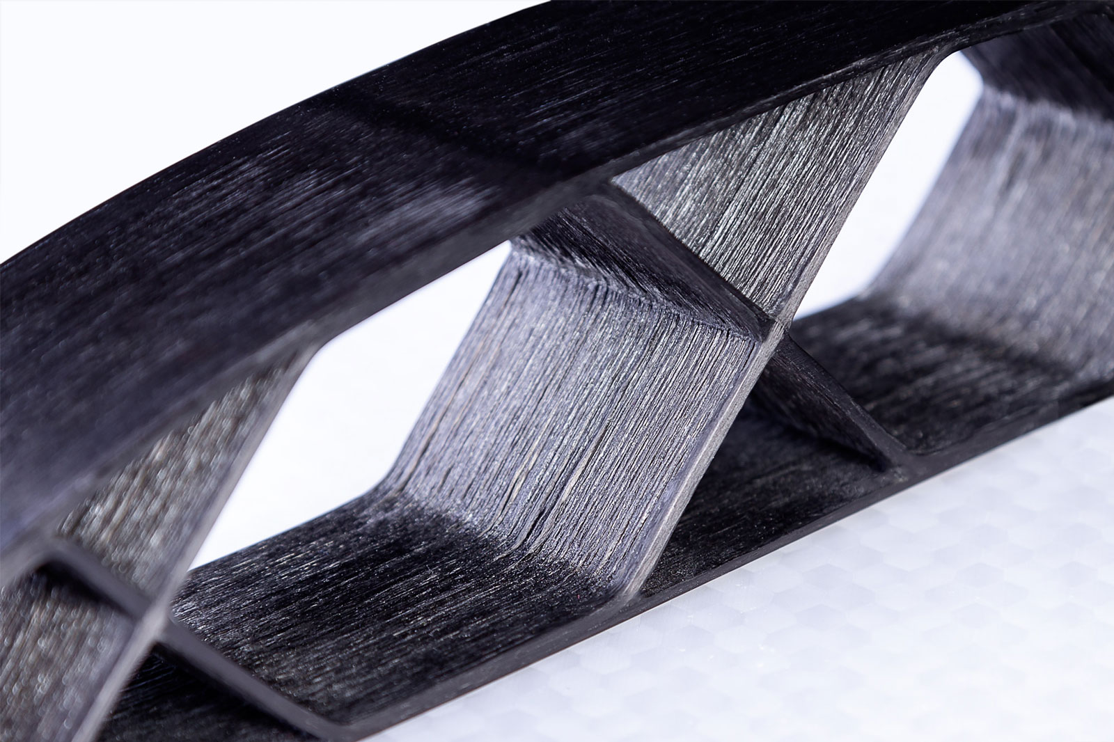 Closeup image of continuous carbon fiber airfoil part