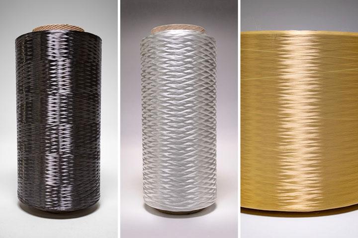 Image of three dry continuous fiber spools. Carbon fiber, fiberglass, and kevlar.