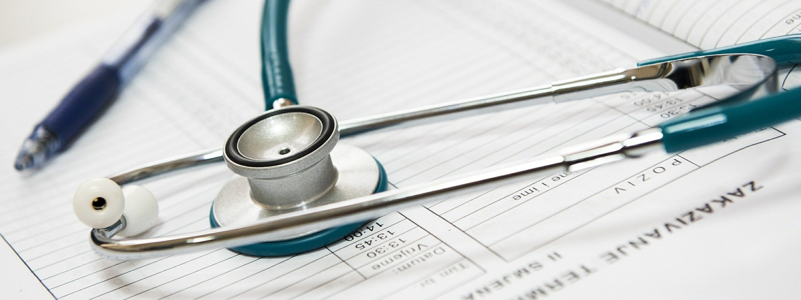 stethoscope on piece of paper new grad nursing credentials