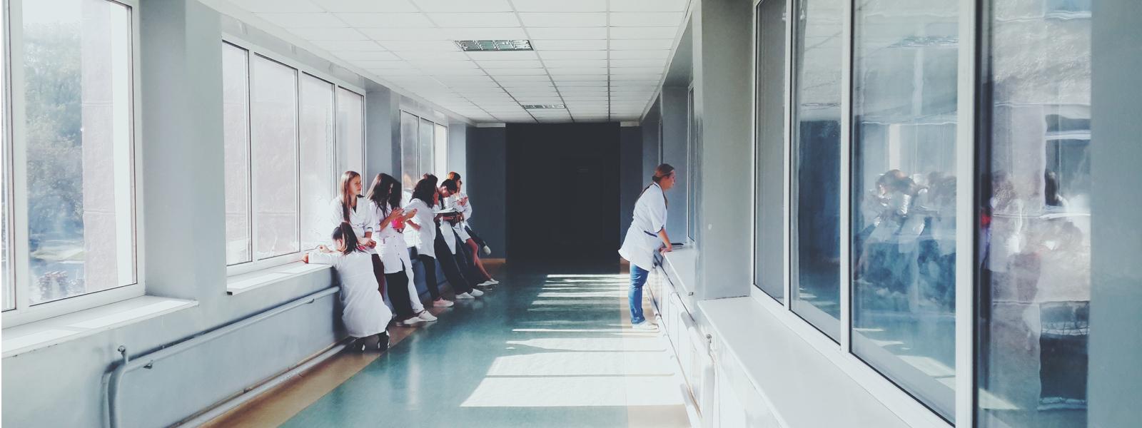 nurses waiting in hallway new grad residency program nursing school