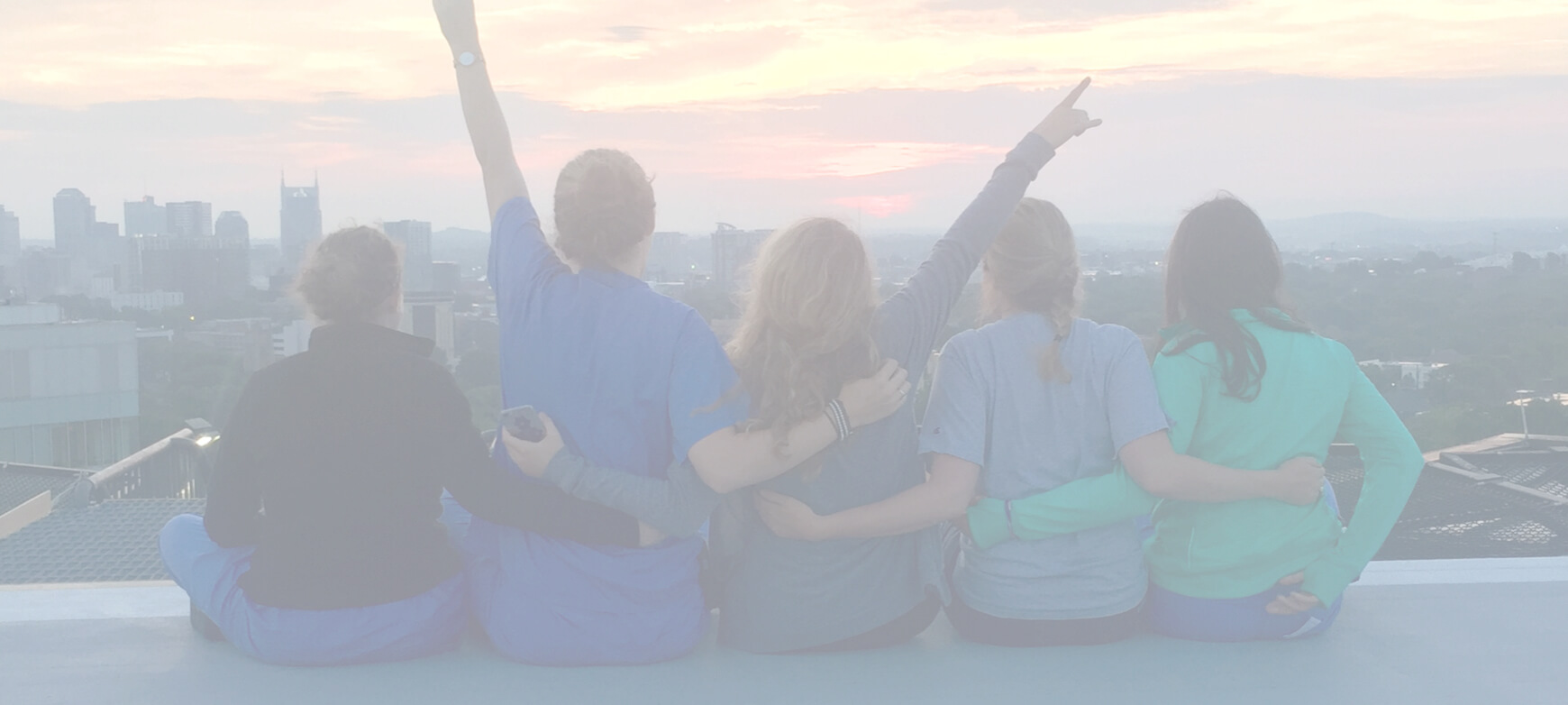 Group of nurses on top of a building