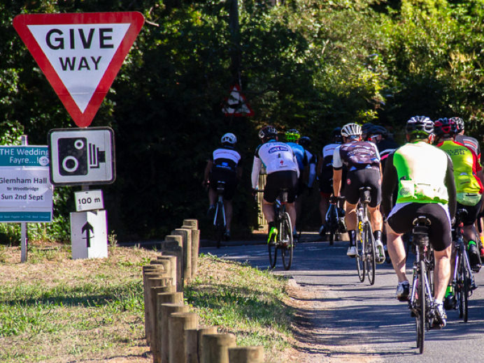 Cyclists with clear signage