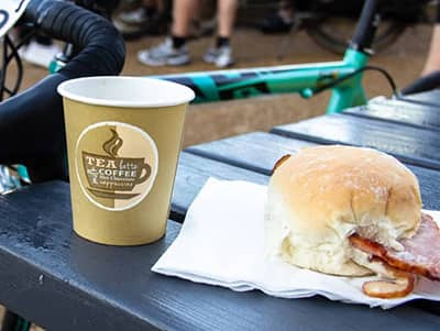 Image of bacon roll with a coffee