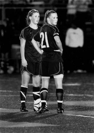 sister nurses sarah and annie gray playing soccer together
