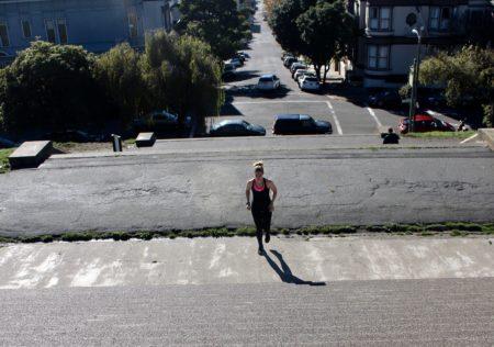 nurse erin kilyroy runs up alta plaza park steps in san francisco