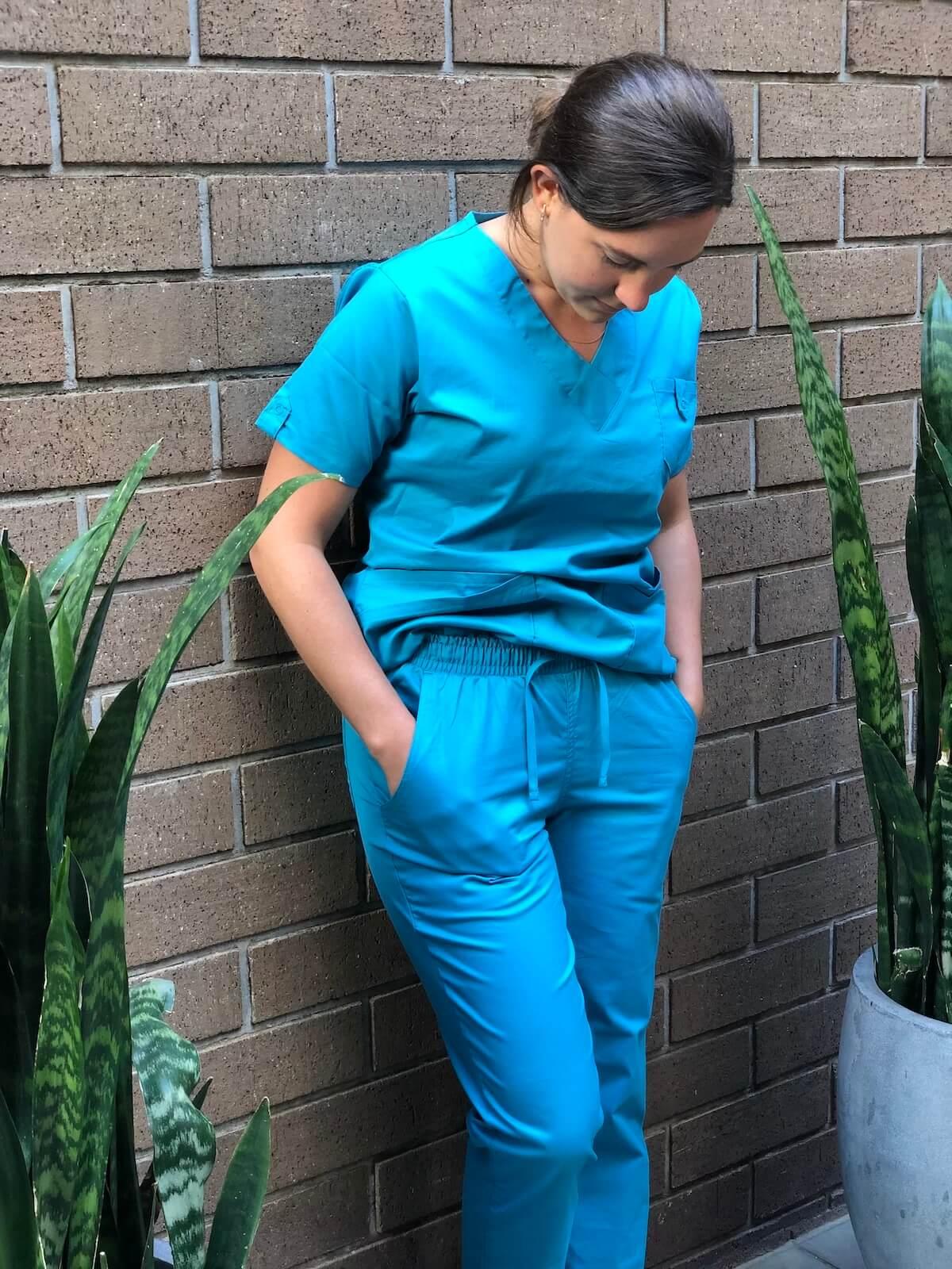 nurse 2 in scrubs leaning against wall uniform advantage scrubs review