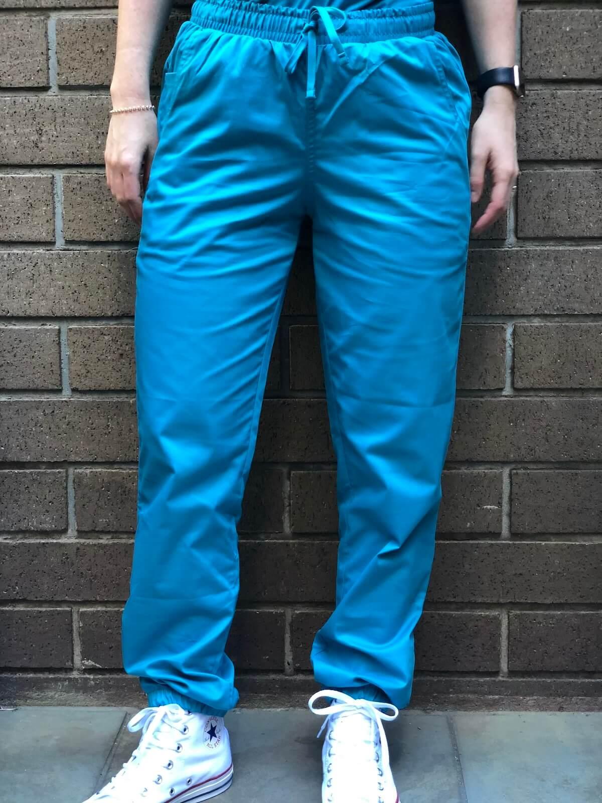 nurse standing in from wall closeup of scrubs pants uniform advantage scrubs review