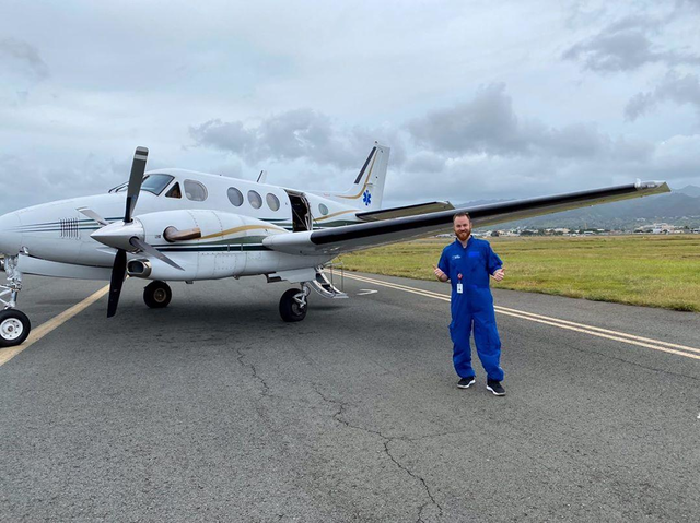 plane on runway with man justin bartlett RN flight nursing