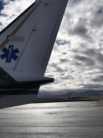 tail of plane on runway flight nursing