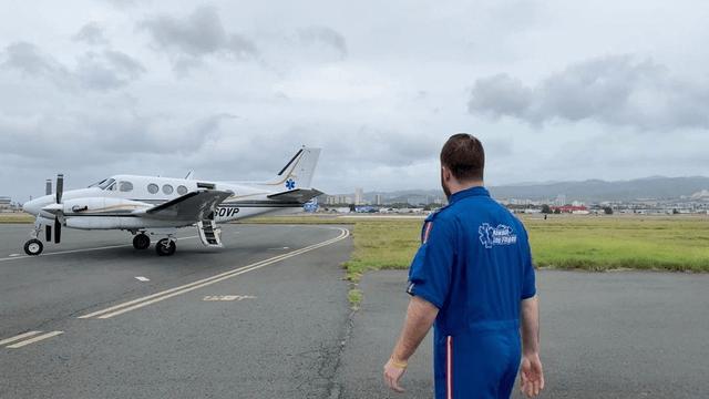 plane on runway man in front justin bartlett RN flight nursing