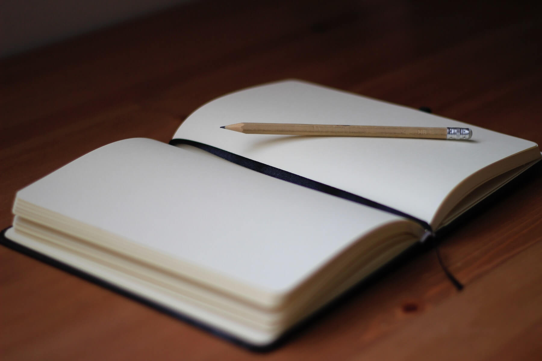 open journal it pencil on wooden table journaling compassion fatigue in nursing