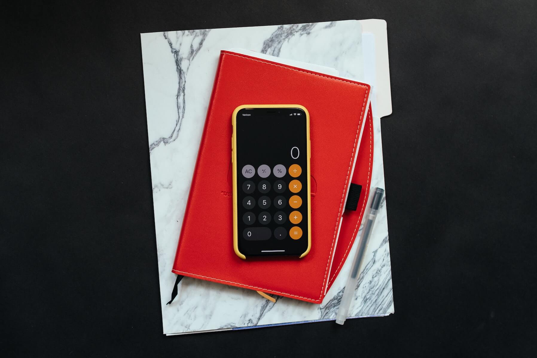 phone on top of notebook and papers financial donations covid19 how to help