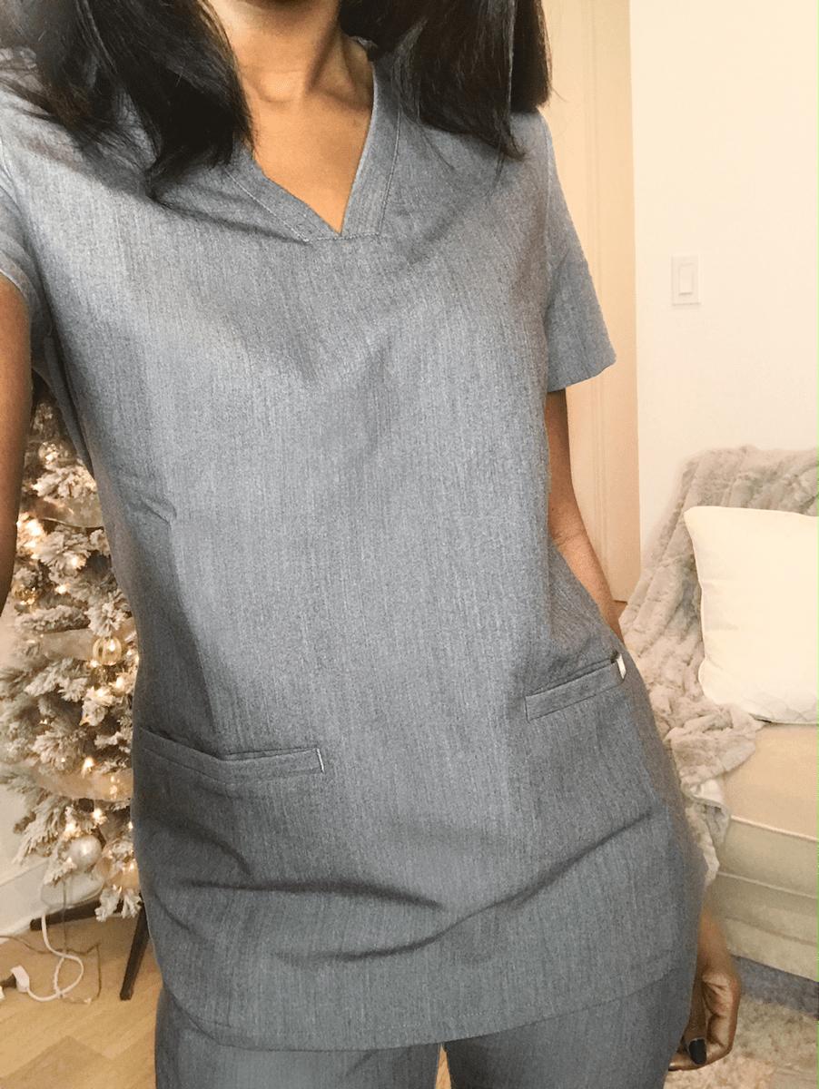 nurse posing in scrubs showing scrubs top figs scrubs review