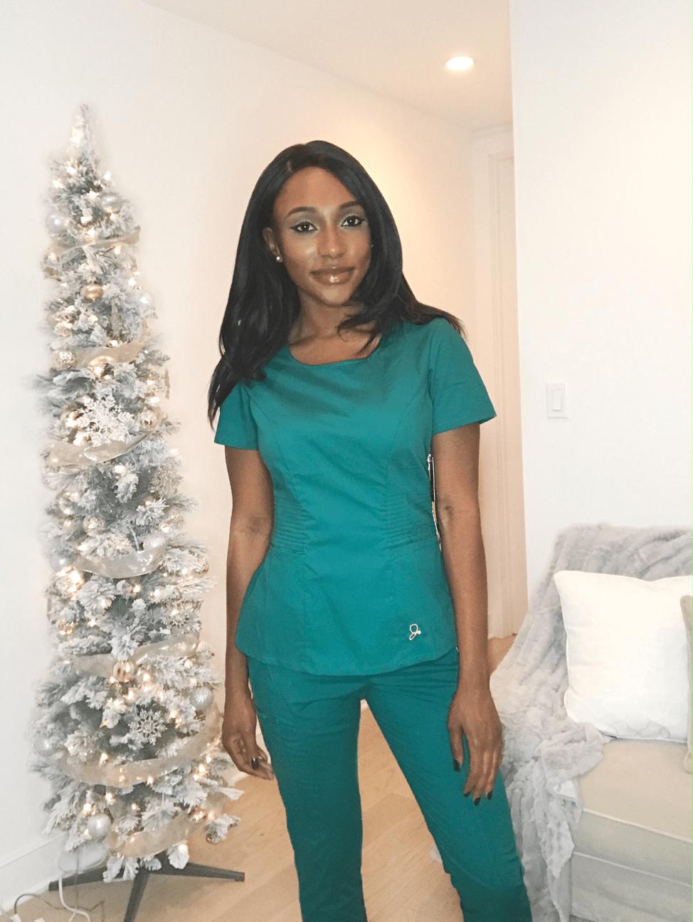 female nurse posing in scrubs side view jaanuu scrubs review
