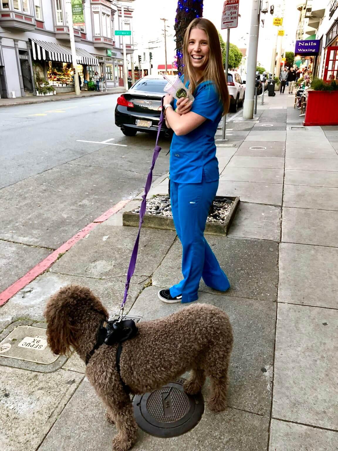 nurse on sidewalk walking dog smiling registered nurse hours 12 hour shifts