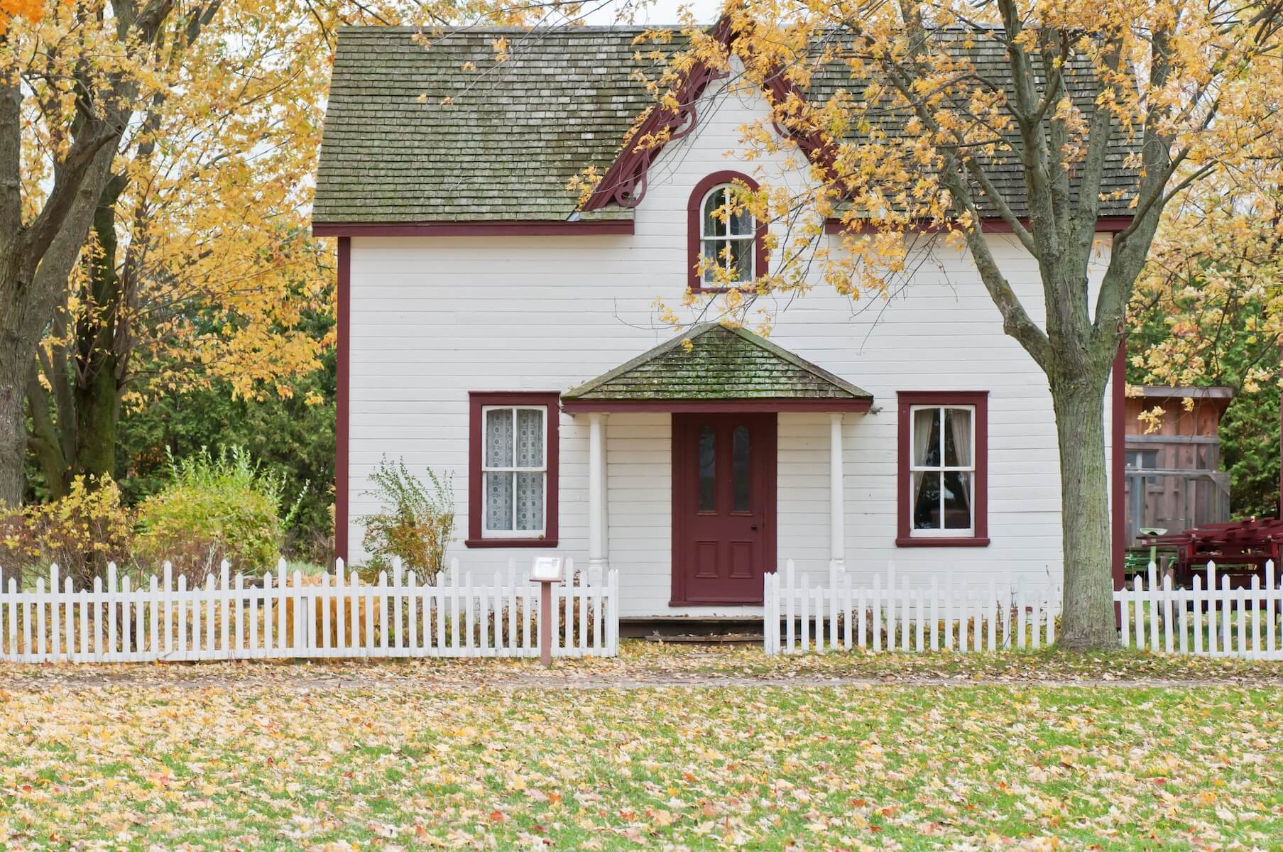 quant country house with small, autumnal front yard travel nurse taxes tax homes
