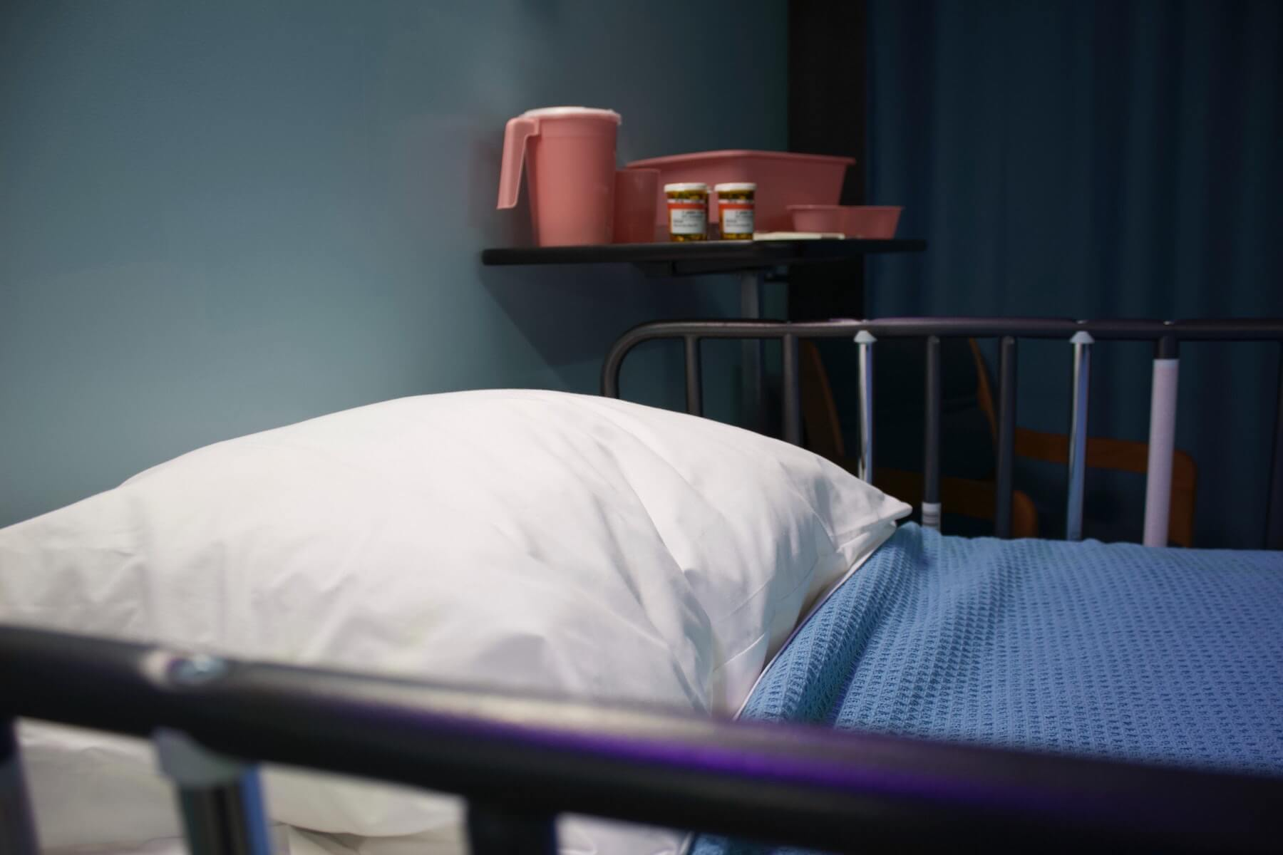 hospital bed in foreground with medications in the background hospice nursing