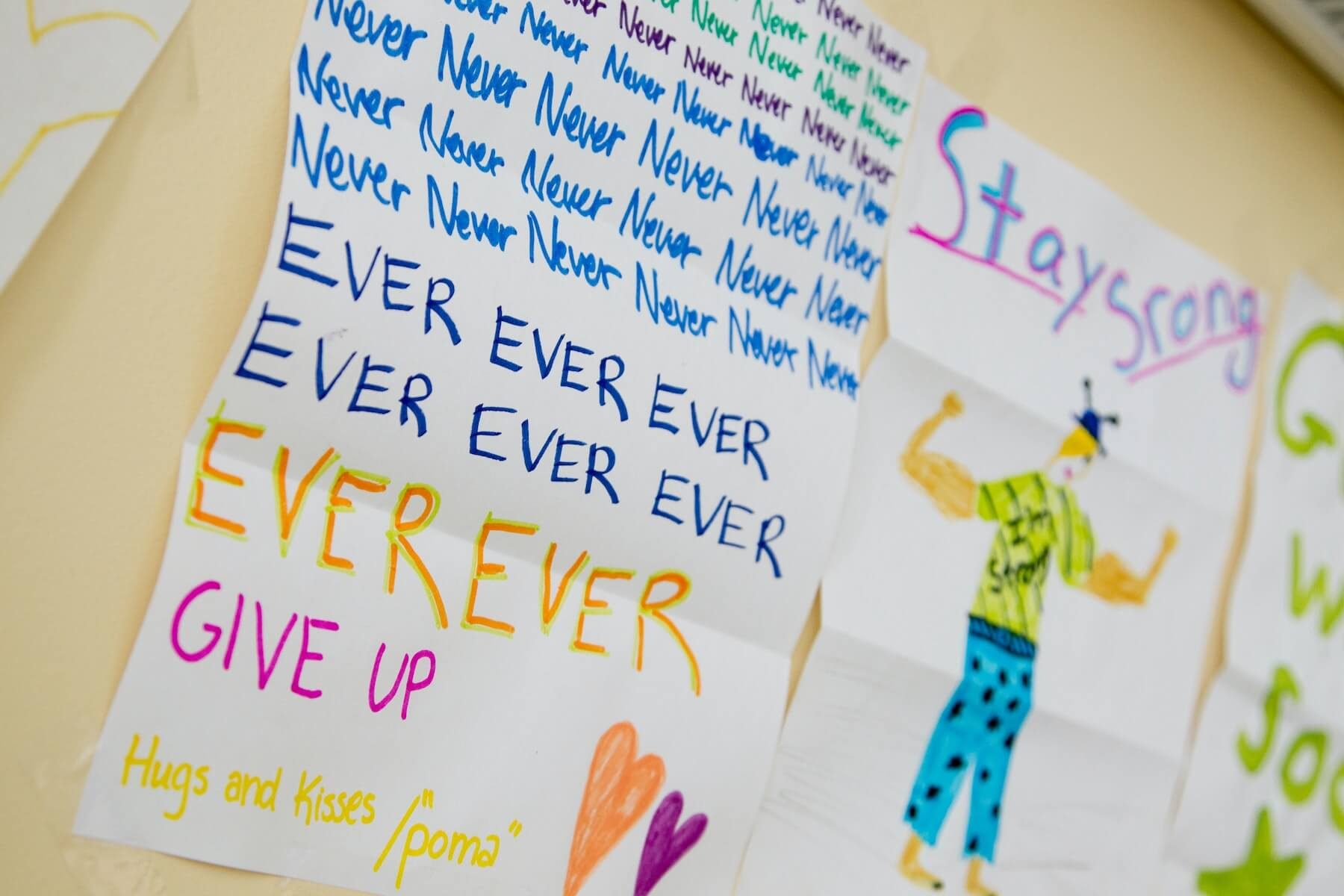 handwritten card saying to never give up and stay strong pediatric nurse