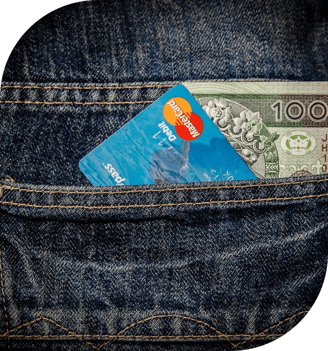 Jeans with a credit card and dollar bills sticking out of it