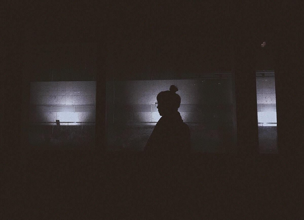 woman in dark hallway scary nursing stories night shift