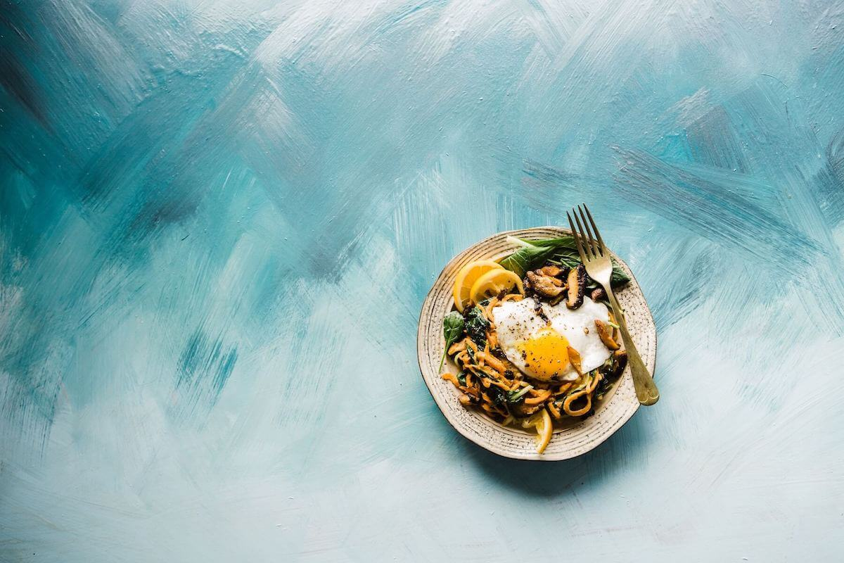 plate of food on blue background traveling food travel food