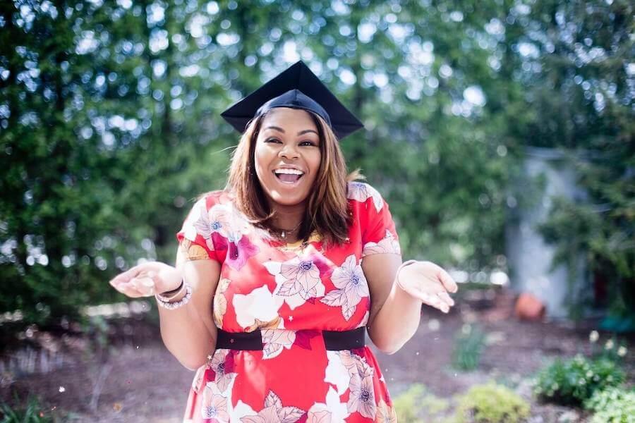 new grad nurse interview questions first job female nurse smiling