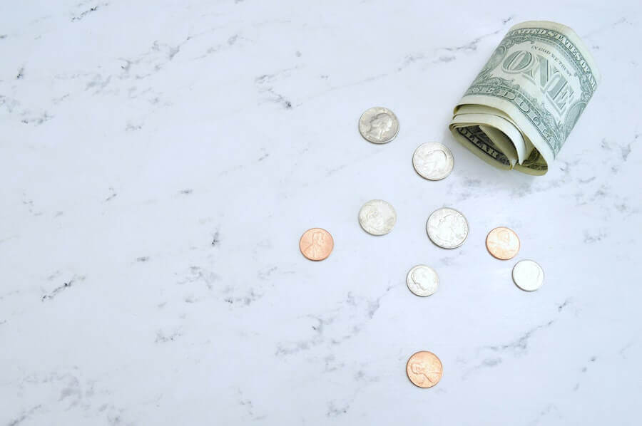 american money on marble table nursing finances
