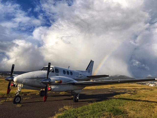 plane on runway in front of rainbow flight nursing