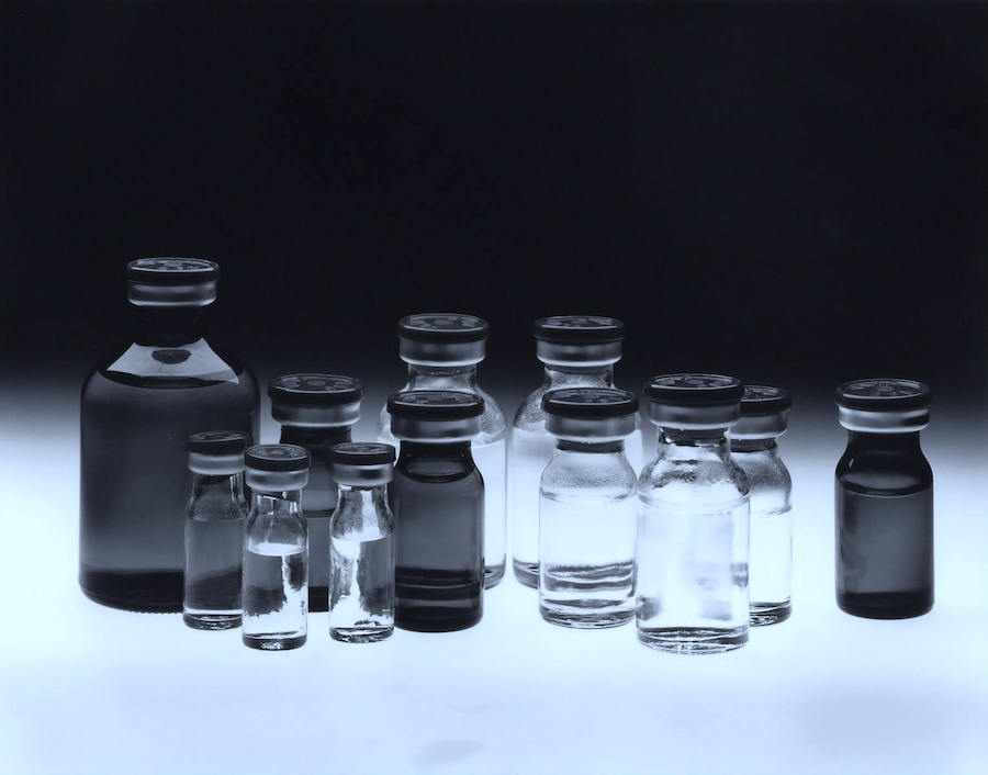 vaccine and medical containers on table